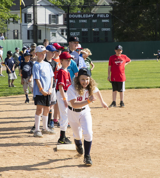 A young fan runs the bases during the 2018 Cooperstown Classic Clinic. (Milo Stewart Jr./National Baseball Hall of Fame and Museum)