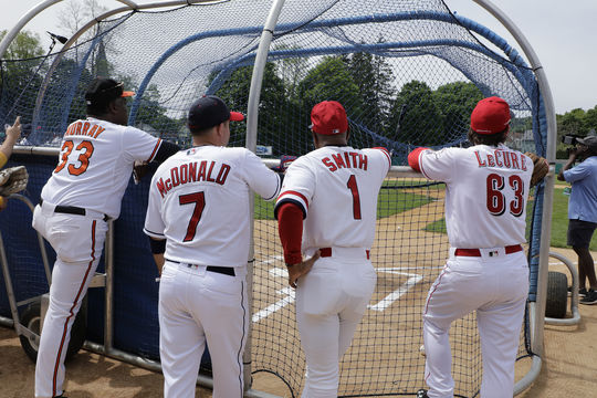 Eddie Murray, John McDonald, Ozzie Smith and Sam LeCure take in batting practice before the start of the 2018 Hall of Fame Classic. (Milo Stewart Jr./National Baseball Hall of Fame and Museum)