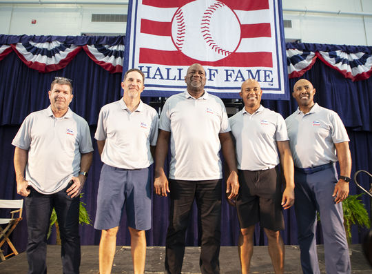 Members of the Class of 2019 pose together onstage prior to a press conference on Saturday of Hall of Fame Weekend 2019. (Milo Stewart Jr./National Baseball Hall of Fame and Museum)