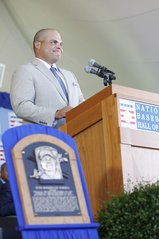 Iván Rodríguez translated parts of his <em>Induction Ceremony</em> speech into Spanish, for his Puerto Rican fans, friends and family in the audience. (Milo Stewart Jr. / National Baseball Hall of Fame and Museum)