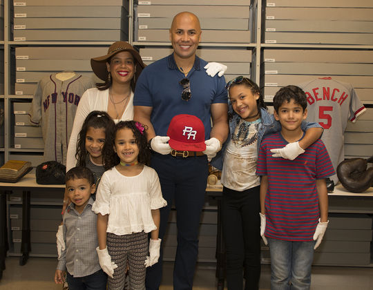 "Carlos Beltrán and his family pose with the team Puerto Rico cap he wore in the 2009 World Baseball Classic. <a href=""https://collection.baseballhall.org/PASTIME/carlos-beltran-world-baseball-classic-cap-2009-march-05-23-5"">PASTIME</a> (Milo Stewart Jr./National Baseball Hall of Fame and Museum)"