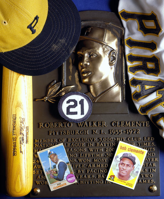 A collage of Roberto Clemente artifacts retained by the Museum & Library, along with his plaque. (Milo Stewart, Jr., National Baseball Hall of Fame Library)