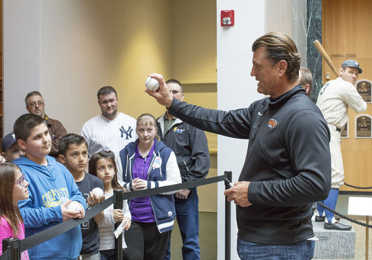 Trevor Hoffman demonstrates his pitching grip to fans in the Hall of Fame's Plaque Gallery on April 4. (Milo Stewart Jr./National Baseball Hall of Fame and Museum)