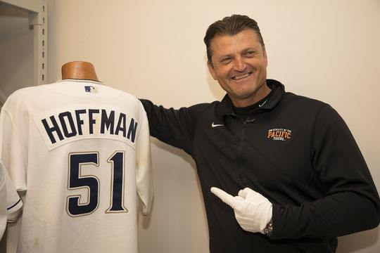 Trevor Hoffman poses with the jersey he wore when he recorded his 500th career save. (Milo Stewart Jr./National Baseball Hall of Fame and Museum)