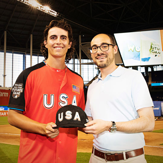 Team USA pitcher Brent Honeywell (left) delivers his 2017 Futures Game cap to Jon Shestakofsky, the Hall of Fame's vice president of communications and education. (Jean Fruth / National Baseball Hall of Fame and Museum)