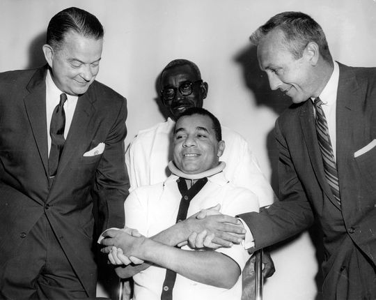 Roy Campanella poses for a picture with Dr. Rush (L) and Dr. Lauman(R) during his recovery. BL-1766-68n (National Baseball Hall of Fame Library)