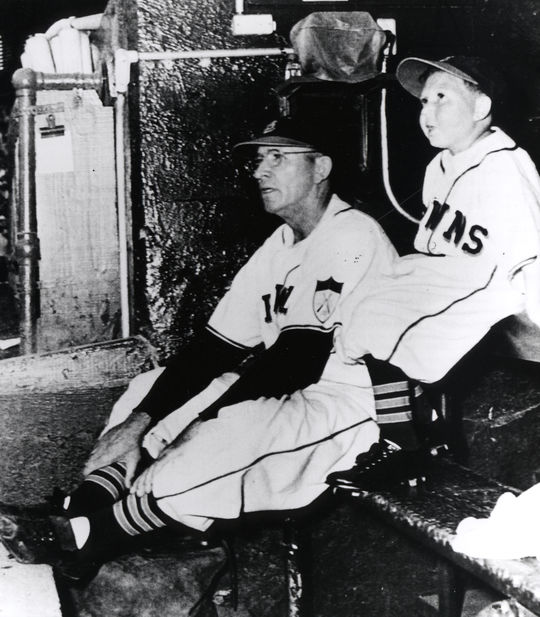 Little person Eddie Gaedel sits in the dugout with St. Louis Browns manager Zack Taylor during his only major league appearance on Aug. 19, 1951. BL-4232-99 (National Baseball Hall of Fame Library)