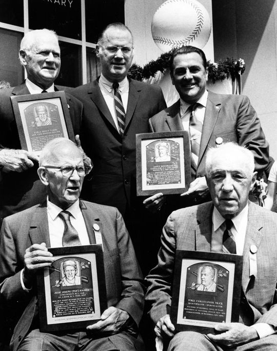 Class of 1970 - standing: Earle Combs, Commissioner Bowie Kuhn, Lou Boudreau; sitting: Jesse Haines, Ford Frick - BL-7925-89 (National Baseball Hall of Fame Library)