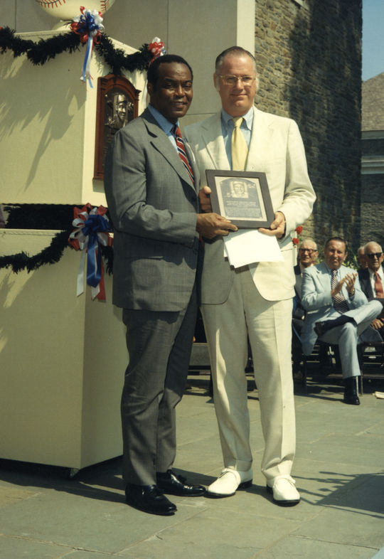 Hall of Famer Monte Irvin poses for a picture with Commissioner Bowie Kuhn during the 1973 Hall of Fame Induction Ceremony. - BL-2065.2002 (National Baseball Hall of Fame Library)