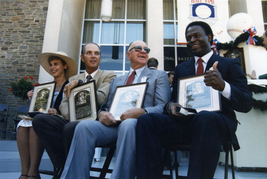 Hall of Fame class of 1985 - Patricia Vaughan Johnson (Arky Vaughan's daughter), Hoyt Wilhelm, Enos Slaughter, Lou Brock. (National Baseball Hall of Fame Library)
