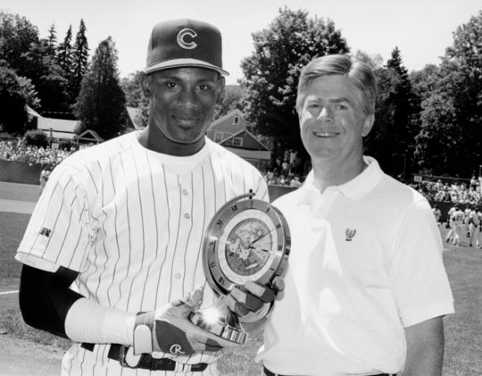 Hall of Fame President, Donald C. Marr, Jr. presents Seiko Clock to Chicago Cubs player, Sammy Sosa, the winner of the pre-game home run hitting contest. BL-13878.95 (National Baseball Hall of Fame Library)