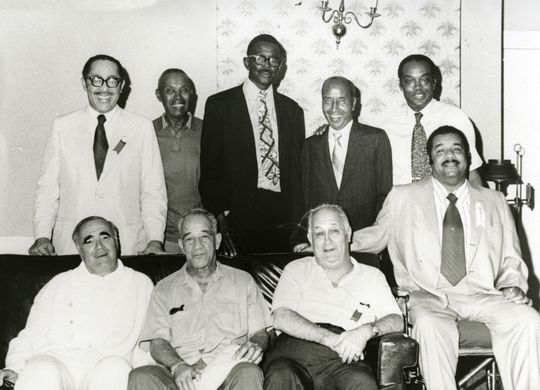 Satchel Paige visits some members of the Hall of Fame Negro Leagues Committee in 1971 <strong>Top row:</strong> Wendell Smith, Judy Johnson, Satchel Paige, Sam Lacy, Monte Irvin. <strong>Bottom Row:</strong> Joe Reichler, Frank Forbes, Eddie Gottlieb, Roy Campanella - BL-495-98 (National Baseball Hall of Fame Library)