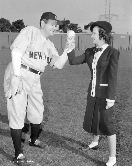 "Hall of Famer Babe Ruth instructs actress Teresa Wright on how to properly throw a baseball on the set of the movie ""The Pride of the Yankees."" Ruth portrayed himself in the baseball classic. - BL-3036.2000 (National Baseball Hall of Fame Library)"