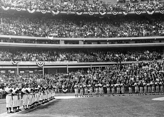 Players and fans stand at attention as the National Anthem is played at Shea Stadium for the April 12, 1965 opener. - BL-4225-68HTj (Don Rice / National Baseball Hall of Fame Library)