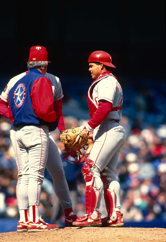 Iván Rodríguez of the Texas Rangers joins a meeting at the pitcher's mound. (Rich Pilling / National Baseball Hall of Fame)