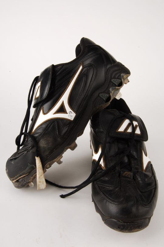 John Smoltz wore these cleats on May 24, 2007, when he defeated the Mets 2-1 for the 200th victory of his career. Smoltz became the first pitcher with 150 saves to reach that milestone. - B-118-2007 (Milo Stewart, Jr./National Baseball Hall of Fame Library)