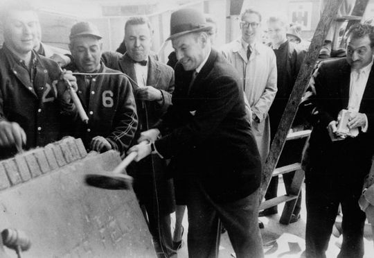 Kratter Corporation vice president Seymour Goldsmith attempts to crack open Ebbets Field's cornerstone during the auction on April 24, 1960 – BL-4793-73 (National Baseball Hall of Fame Library)