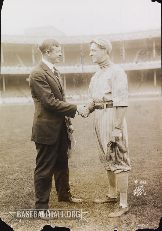 """Christy Mathewson (left) shakes the hand of actor William Courtenay, with whom he collaborated to create the play, """"The Girl and the Pennant."""" <a href=""""https://collection.baseballhall.org/PASTIME/christy-mathewson-and-william-courtenay-photograph-1913-october-23-0"""">PASTIME</a> (National Baseball Hall of Fame and Museum)"""