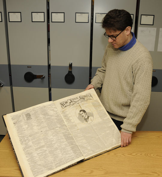 Hall of Fame senior curator Tom Shieber pages through the Museum's bound copies of the New York Clipper newspaper. The papers were donated to the Museum by Margery Cary of Richfield Springs, N.Y., a town just to the north of Cooperstown. (Milo Stewart, Jr. / National Baseball Hall of Fame)