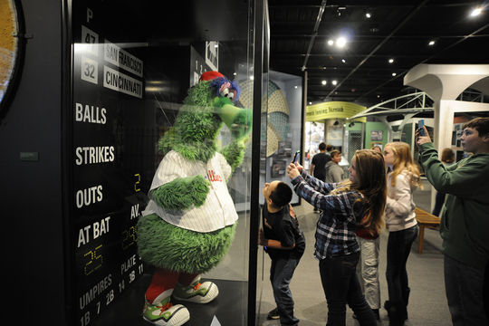 Young visitors take a close-up shot of the Phillie Phanatic while exploring the second floor of the Museum. (Milo Stewart Jr. / National Baseball Hall of Fame and Museum)